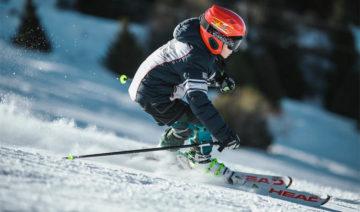 man-doing-ice-skiing-on-snow-field
